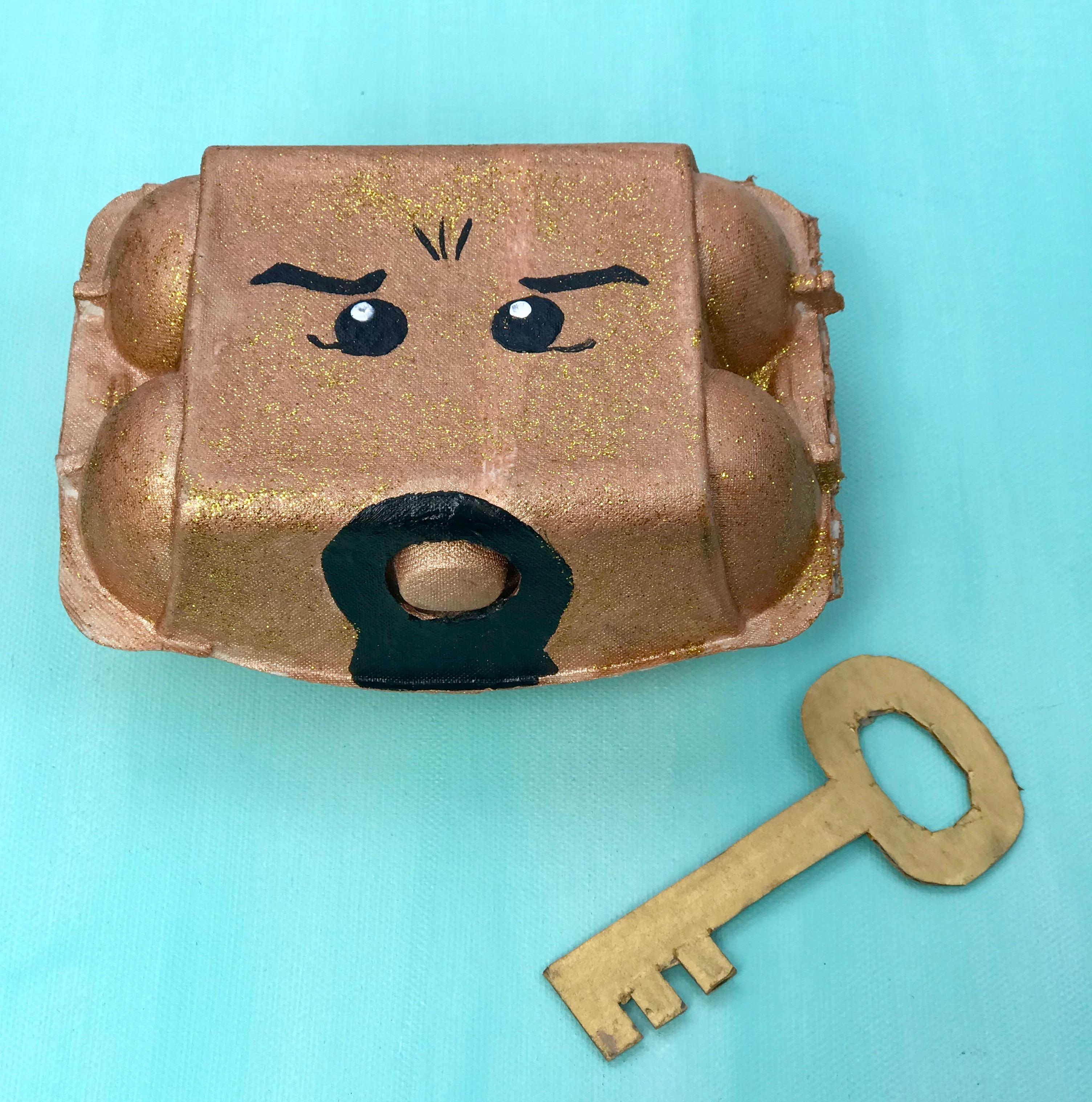ninjago-geburtstag-spiel-idee-schatztruhe-aus-eierkarton-basteln-upcycling